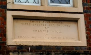 The dedication stone above the centre door of Francis Wigg's almshouse. 2017 | Colin Wilson