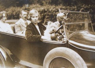 Eileen, driving her father George and sister Eva, with Robin the dog