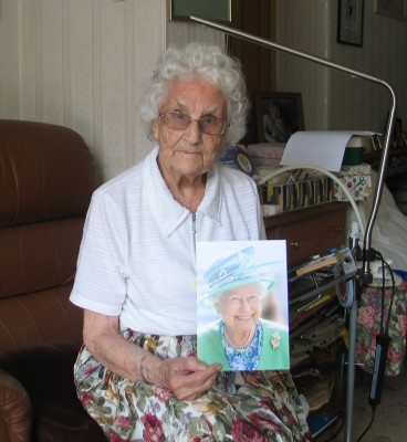 Agnes Taylor nee Mant, with her congratulatory card from HRH The Queen.