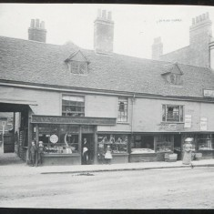 These buildings stood on the site which was bequeathed, with the yard behind, to Hertford's Poor Estate, a local charity. It was decided by the charity to build a post office on the site and lease it to the government as a way of gaining income on their property. The high building on the right is the Dimsdale Hotel and next to it is the Talbot Arms, later rebuilt and now The Decorated Room. The shop of Mr Savage, cooper and basketmaker, was demolished to make way for the new Post Office. On the left of this picture is the entrance to Paradise Court. Such courts existed off all the main streets of the town. | Hertfordshire Archives and Local Studies/Mr Elsden