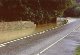Brick boundary of the road, broken by the flood water | Anon.