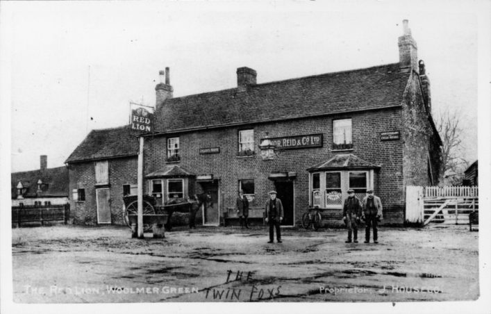 Local Poachers & petty criminals the Fox twins standing outside the Red Lion (far right), early 20th Century | Woolmer Green Parish Council