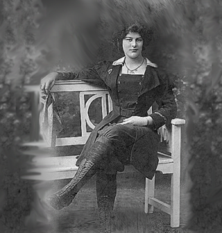 Dolly Shepherd sat down on a bench holding the silken Union Jack Handkerchief that she would use to wave at the crowds as she made her ascent under a balloon.