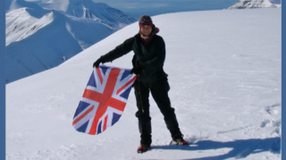 Lucy Shepherd Holding a Union Jack Flag on a Snow Capped Mountain