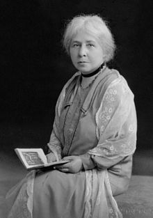 Photo of Margaret Murray, Egyptologist. siting down with a book.