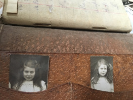 George's Pocket Notebook with Photos of sisters, Lily and Rose