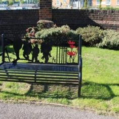 Memorial Benches in memorial garden next to the entrance of Hatfield House. AL9 5AB   Eric Riddle