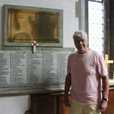 Ware. Inside Christ Church, New Rd, SG12 7BS with Eric stood infront of the memorial. | Eric Riddle