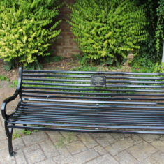 Hertford. Old Cross outside the Old Library SG14 1RB. A bench in remembrance of Lt Colonel Frank Page DSO, Mayor of Hertford 1912, on the 100th anniversary of him dying in active service at the Battle of S Julien, July 31st 1917.  | Eric Riddle