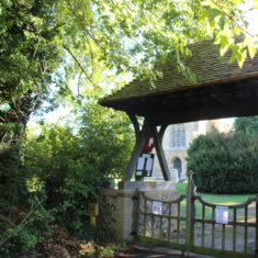 Great Wymondley. Memorial on wooden rafters of gate at entrance to Church. Church Green, SG4 7EX | Eric Riddle