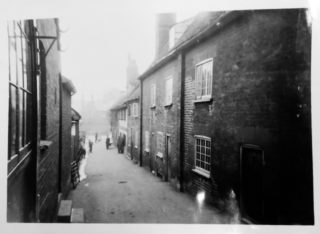 The original buildings in Biggin Lane | Photograph by H Minnis. Included in the minutes book for 1932. Courtesy of Hertfordshire Archives and Local Studies ref NR8/11/3