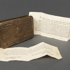 Christmas tins, Cigarette cases and a one hundred year old biscuit from Army rations