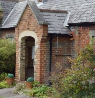 One of the porches. Note the brickwork which may indicate some alterations. 2016 | Colin Wilson