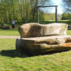 A seat made from trees, with The Henge entrance behind | Colin Wilson