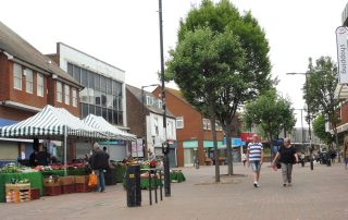 The market stalls. One is almost hidden behind the trees. 3 Jun 2020 | Colin Wilson