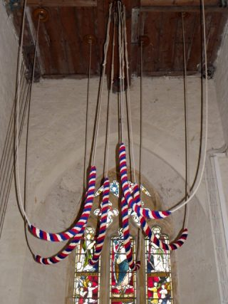 Bell ropes hanging in a tower