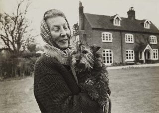 At Rooks Nest with her terrier | Hertfordshire Archives and Local Studies (Acc 6065)