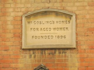 The datestone above the porch on Gosling House. The Charity began in 1896 but Gosling House was built a decade later. May 2017 | Colin Wilson