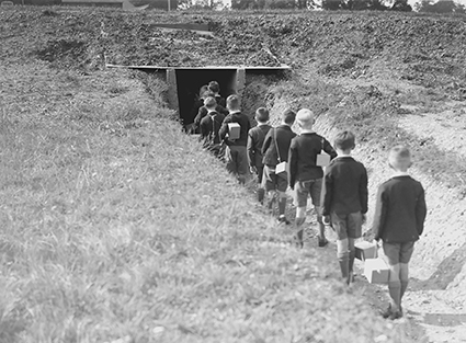 Children going into a bomb shelter | HALS (ref WatGrv 0165-00-13)
