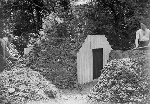 Two men building an Anderson shelter in a Watford garden | Two men building an Anderson shelter in a Watford garden, 1940 (HALS ref WatGrv 0220-00-17)