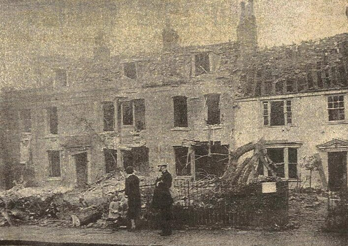 Photo from a newspaper showing bomb damaged houses in Barnet | Houses in Wood Street, Barnet, damaged by a bomb on 18 October (HALS ref Acc 4525)