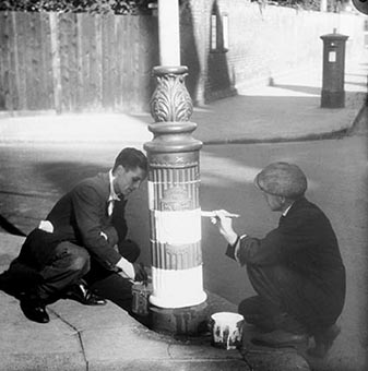 Two men painting a lampost for the blackout | HALS (ref WatLns 0507-00-08)