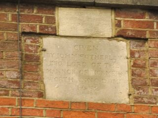 The dedication stone now on the replacement building. The upper stone reads 'The stone below was taken from the old almshouses demolished .....' The lower stone reads 'Given by John Fotherley Esq. Lord of the Manor of Rickmersworth Anno Domi 1682'. April 2017 | Colin Wilson