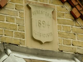 The datestone on one of the gables on the Beresford almshouses in Bury Lane. April 2017   Colin Wilson