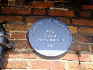 The Heritage Trail sign on the end of the almshouse. 2016 | Colin Wilson