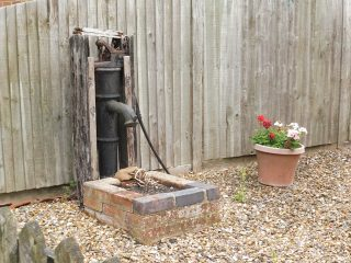 The water pump at the north end of Much Hadham almshouse. Aug 2020 | Colin Wilson