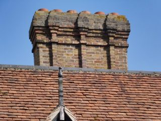 One of the ornate chimneys on the formare Eastwick almshouse. Aug 2016 | Colin Wilson