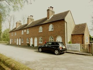 Day's almshouse. The letter box is clearly visible just by the front of the car. Dec 2017 | Colin Wilson
