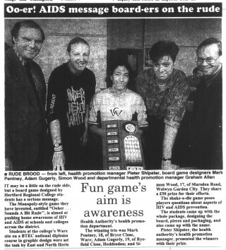 Article in the Hertfordshire Mercury about students at Hertford Regional College who designed a game to raise AIDS awareness. There is a photograph of the three students with the health promotional manager and departmental health promotion manager.