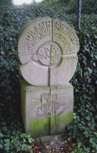 A colour photograph of the statue to E M Forster in St Nicholas' churchyard in Stevenage