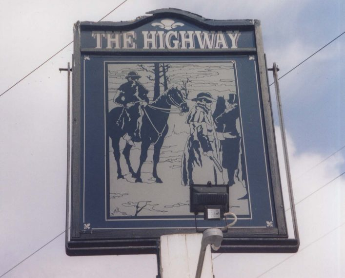 A photograph of a pub sign for The Highway pub in Hoddesdon. The sign shows a highwayman on a horse and another one on foot holding his hand out asking for money from another figure. | Hertfordshire Archives and Local Studies, DE/X1024/1/73/67.