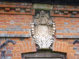 The cartouche above the front door. Sep 2017 | Colin Wilson