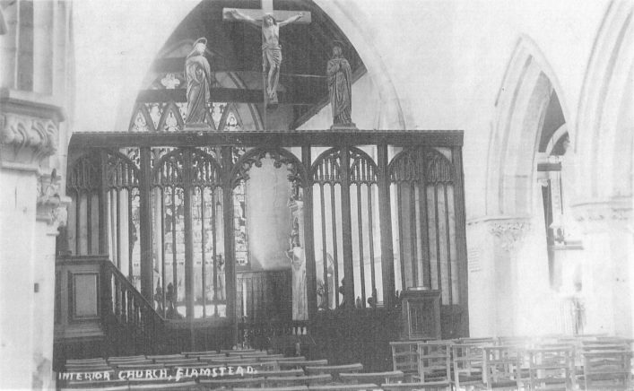 Rood screen with carved figures above in St Leonard's church, in the 1910s, b&w photo | Mary Mealey Collection