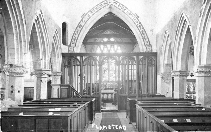 Interior of St Leonard's church, 1900s, showing unadorned rood screen and inscription, b&w photo | C Motley postcard collection
