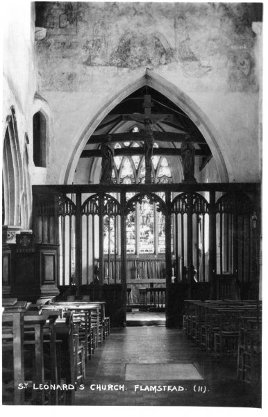 Interior of St Leonard's showing rood screen with figures added, from the 1920s | C Motley postcard collection