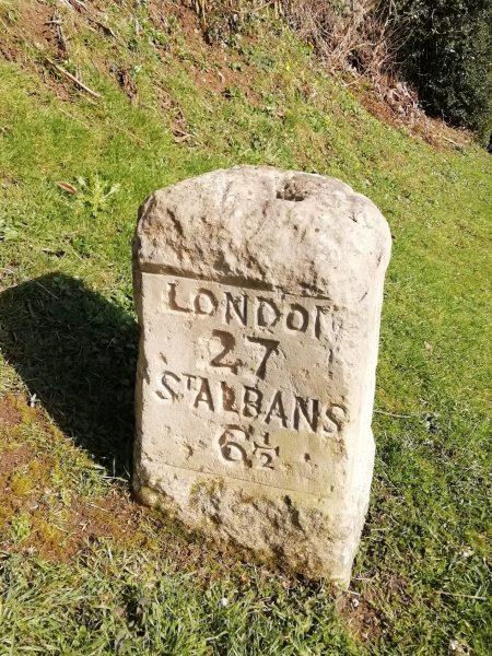 Granite milestone on Old Watling Street showing London 27, St Albans 6 1/2 miles, col photo   D Lynch