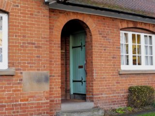 An entrance porch , with the foundation stone to the left. Feb 2017 | Colin Wilson