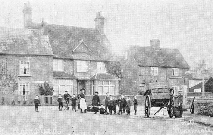 Villagers at the pump at the corner of High St and Chapel Rd in the 1900s, b&w photo | E Mott, Markyate. Postcard collection of C Motley