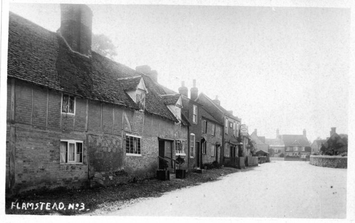 View up High Street towards Chapel Road, houses and Spotted Dog, 1920s, b&w photo | C Motley postcard collection