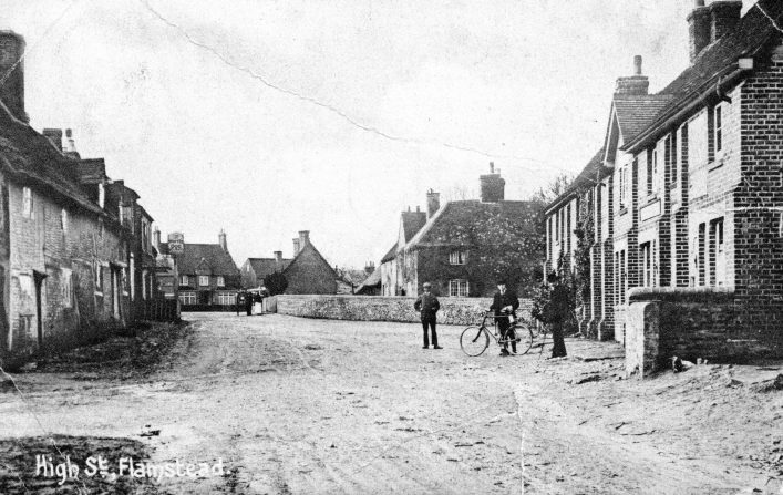 View up High Street towards Chapel Road, post office, houses and Spotted Dog, 1920s, b&w photo | C Motley postcard collection