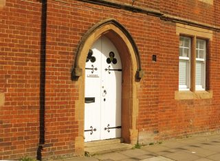 The main door to Warner's almshouse, with a disrceet nameplate. May 2017 | Colin Wilson