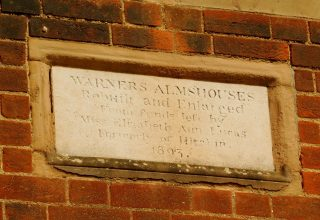 The dedication stone above the main door, Warner's almshouse. May 2017 | Colin Wilson