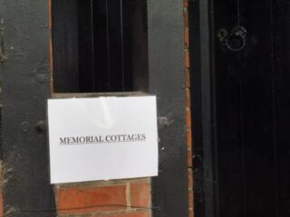 The paper sign on the almshouse door. Sep 2016 | Colin Wilson