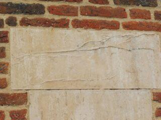 Dedication stone, now illegible, Saunders almshouse. Oct 2016 | Colin Wilson