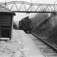 Tank engine and brake van reaching Roundwood Halt after the long pull from Harpenden. Water levels would be checked here. April 1955. | © Michael Covey-Crump