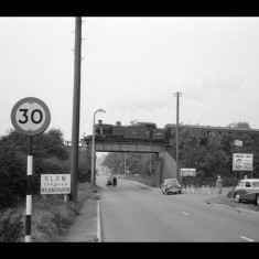 The bridge across the A5 just south-west of Redbourn Station, with a 'special' train, September 1960. | © Michael Covey-Crump